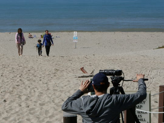 """Lee Schneiderman shoots B-roll footage at Mandalay Beach in Oxnard for the PBS show """"Family Travel."""" An episode of the show was being filmed in and around Oxnard."""