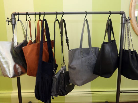 Handbags produced by Brittney MacKenzie, owner of an eco-friendly handbag line called MacKenzie83, photographed June 20, 2018 in New City. MacKenzie, who graduated from Clarkstown North High School, started her handbag business in Aug. 2017.