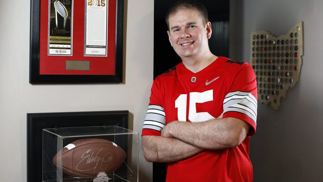 Eric Stockman shows Ohio State memorabilia in his basement near Polaris. He attended OSU football games with his father while growing up and remained a Buckeyes supporter even while attending Bowling Green State University.