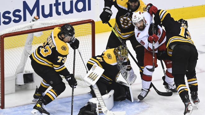 Bruins goaltender Jaroslav Halak makes a save as teammates Charlie McAvoy,  Zdeno Chara and Charlie Coyle, from left, try to keep the Hurricanes' Vincent Trocheck away from the rebound during a game on Wednesday. A condensed Round 2 schedule will make it tough on everyone, especially the goaltenders.
