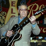 """This April 30, 2003, file photo shows Scotty Moore, a former guitarist for Elvis Presley, playing music at the 2nd annual Ponderosa Stomp in New Orleans. Moore, the pioneering rock guitarist who played on """"Hound Dog"""" and other early Elvis Presley hits, has died. He was 84."""