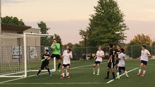 Topeka High goalkeeper Culhan Carr makes a leaping save against Hayden in Wednesday's 1-0 Trojan soccer victory at Hummer Sports Park.