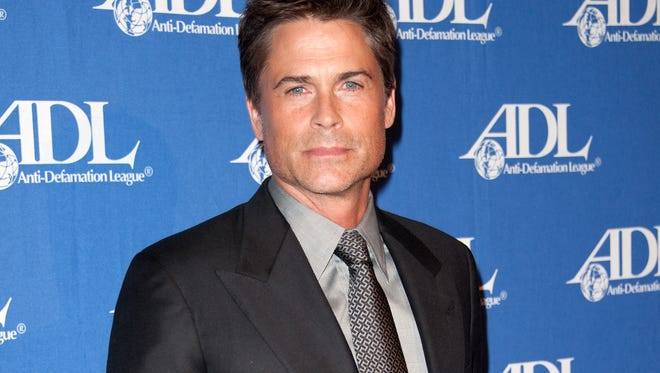 FILE - In this Oct. 16, 2012 file photo, actor Rob Lowe attends the Entertainment Industry Awards Dinner at the Beverly Hilton Hotel in Beverly Hills, Calif. Lowe stars in ads for DirecTV encouraging people to switch from cable. (Photo by Richard Shotwell/Invision/AP, File) ORG XMIT: NYET201