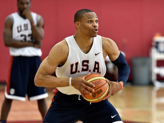 FILE - In this Aug. 11, 2015, file photo, Russell Westbrook looks to pass the ball during the U.S. men's basketball team's minicamp in Las Vegas. Westbrook says he won't play in the Olympics, leaving the U.S. basketball team without another of its best players. The Oklahoma City point guard said Friday, June 10, 2016,  that he decided not to play after talking with his family. He didn't give a reason for pulling out in his statement released through the Thunder. ((AP Photo/David Becker, File)