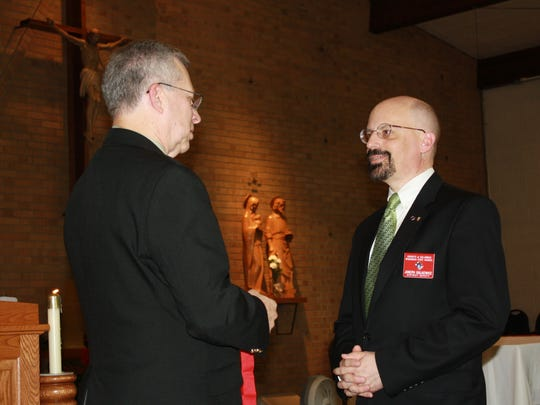 Ronald Faust, left, state deputy for Wisconsin Knights of Columbus, recently appointed Joseph Dutkiewicz, right, of De Pere as district deputy. Dutkiewicz will work with the Knights of Columbus councils in De Pere, Oneida, Ashwaubenon and Freedom.