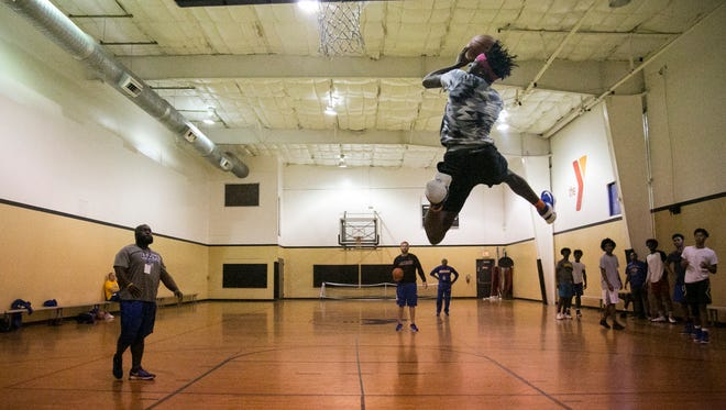 Jaquavious Horton goes up for a dunk during practice with his teammates from Jemison High School in Huntsville, Alabama, on Friday at the YMCA in Fort Myers.