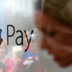 he Apple Pay logo is displayed in a mobile kiosk.