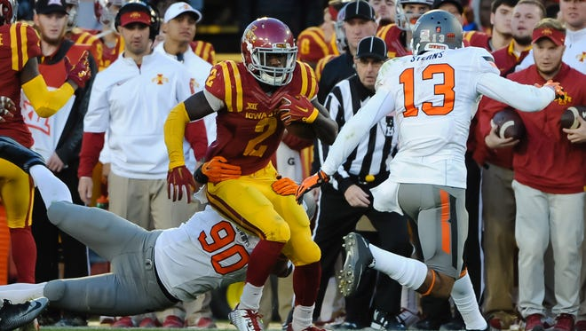 Iowa State running back Mike Warren (2) cracked the 1,000-yard mark for the season Saturday against Oklahoma State.
