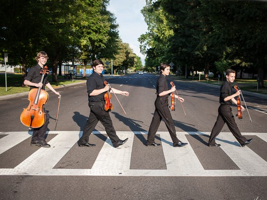 "Etherius String Quartet members Hendrick Mobley, from left, Joseph Miletta, Nicholas Silver and Damon Zavala re-create the album cover of ""Abbey Road."" The quartet will perform in ""In My Life — A Musical Theatre Tribute to the Beatles"" on Oct. 24 at the Historic Elsinore Theatre."