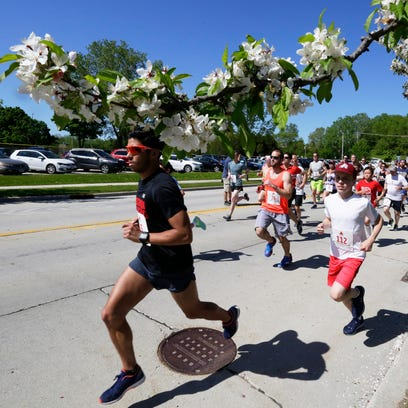 Runners sprint at the start of the Sheboygan A's 5k