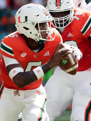 FILE - In this Sept. 22, 2018, file photo, Miami quarterback N'Kosi Perry scrambles during the first half of an NCAA college football game against FIU, in Miami Gardens, Fla. Perry and Florida State's Deondre Francois will certainly be the centers of attention Saturday when the Seminoles (3-2, 1-2 Atlantic Coast Conference) visit the 17th-ranked Hurricanes (4-1, 1-0). (AP Photo/Lynne Sladky, File)