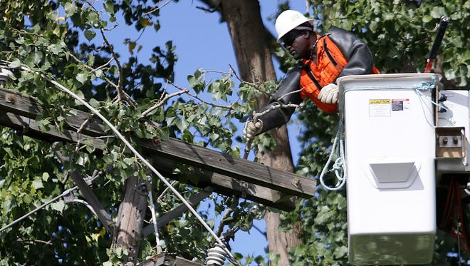 Armed robbers are victimizing DTE crews. 2013 file photo by Kimberly P. Mitchell/Detroit Free Press