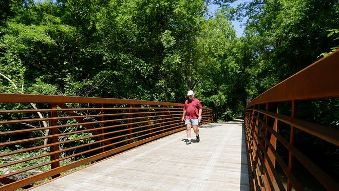 Marty Schindelholz of Fond du Lac walks across a newly constructed bridge on the Peebles Trail in Taycheedah. The trail runs from Fond du Lac through Peebles to St. Peter in the Holyland. The bridge is 80 feet long and 10 feet wide.