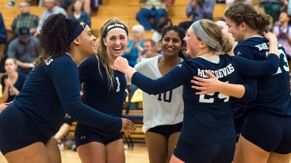 Greencastle celebrate after winning their set during a girls volleyball game against Waynesboro on Tuesday, Oct. 4, 2016. Greencastle defeated Waynesboro 3-0