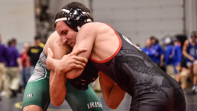 Marion Harding's Bryce Cook-McCoy tries to find a way to pull Dublin Scioto's Malek Mustafa down to the mat during the Marion County Wrestling Tournament at the Veterans Memorial Coliseum on Friday and Saturday.