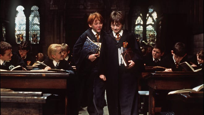"""Actors Rupert Grint as """"Ron Weasley"""" (left) and Daniel Radcliffe as """"Harry Potter"""" are shown in a scene from """"Harry Potter and the Sorcerer's Stone""""."""