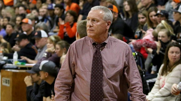 Bowie head basketball coach Doug Boxell watches his team play Nocona Tuesday, Dec. 19, 2017, in Nocona.