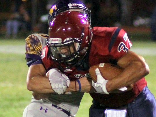 Cat back Trini Garcia III (37) collected tough yardage during Friday's 47-26 loss to the visiting Burges Mustangs.