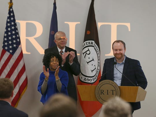 Austin McChord, right, RIT 2009 alumnus, gives $50 million to RIT Wednesday, Dec. 13, 2017, in Henrietta. The gift is the largest ever made to the university.  With McChord is RIT President David Munson Jr., left., and an unidentified sign language interpreter.