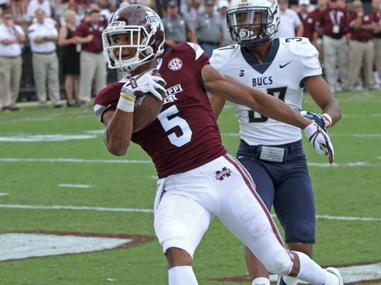 Mississippi State wide receiver Gabe Myles (5) catches a pass for a touchdown ahead of Charleston Southern defensive back Sekwan Jenkins.