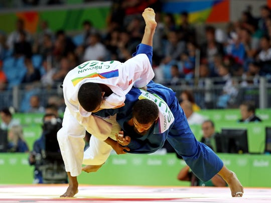Aug 10, 2016; Rio de Janeiro, Brazil;  Colton Brown (USA) fights Iszlam Monier Suliman (SUD) in the men's judo 90kg round of 32 in the Rio 2016 Summer Olympic Games at Carioca Arena 2.
