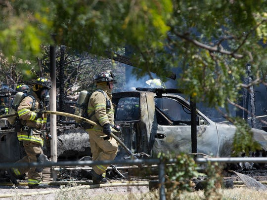 Fire fighters from Doña Ana County worked to put out a shed and car port on King Edwards Ave. Monday September 11, 2017.
