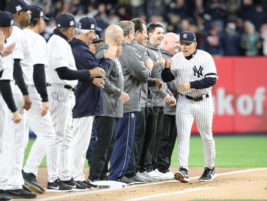 Yankees Manager, Joe Girardi, is shown along the first