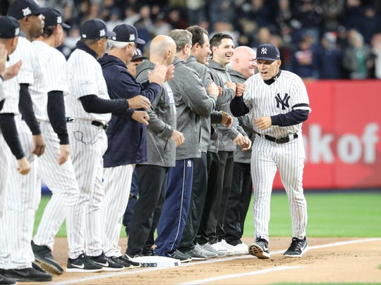 Yankees Manager, Joe Girardi, is shown along the first base line before Game 3 of the ALCS, Monday, October 16, 2017.
