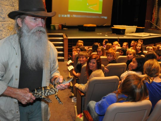 Gator Bill Robb hosts an educational presentation - complete with snakes, alligators and snapping turtles, at DeLaura Middle School in 2013.