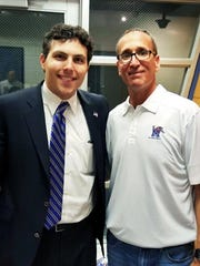 University of Memphis coach Josh Pastner and Tucson, Arizona, resident Ron Bell pose for a photo after Memphis' 63-59 win over Cincinnati at FedExForum on Saturday. Bell, 49, drove from Tucson to Memphis last week in a show of support for Pastner, who he says saved his life twice.