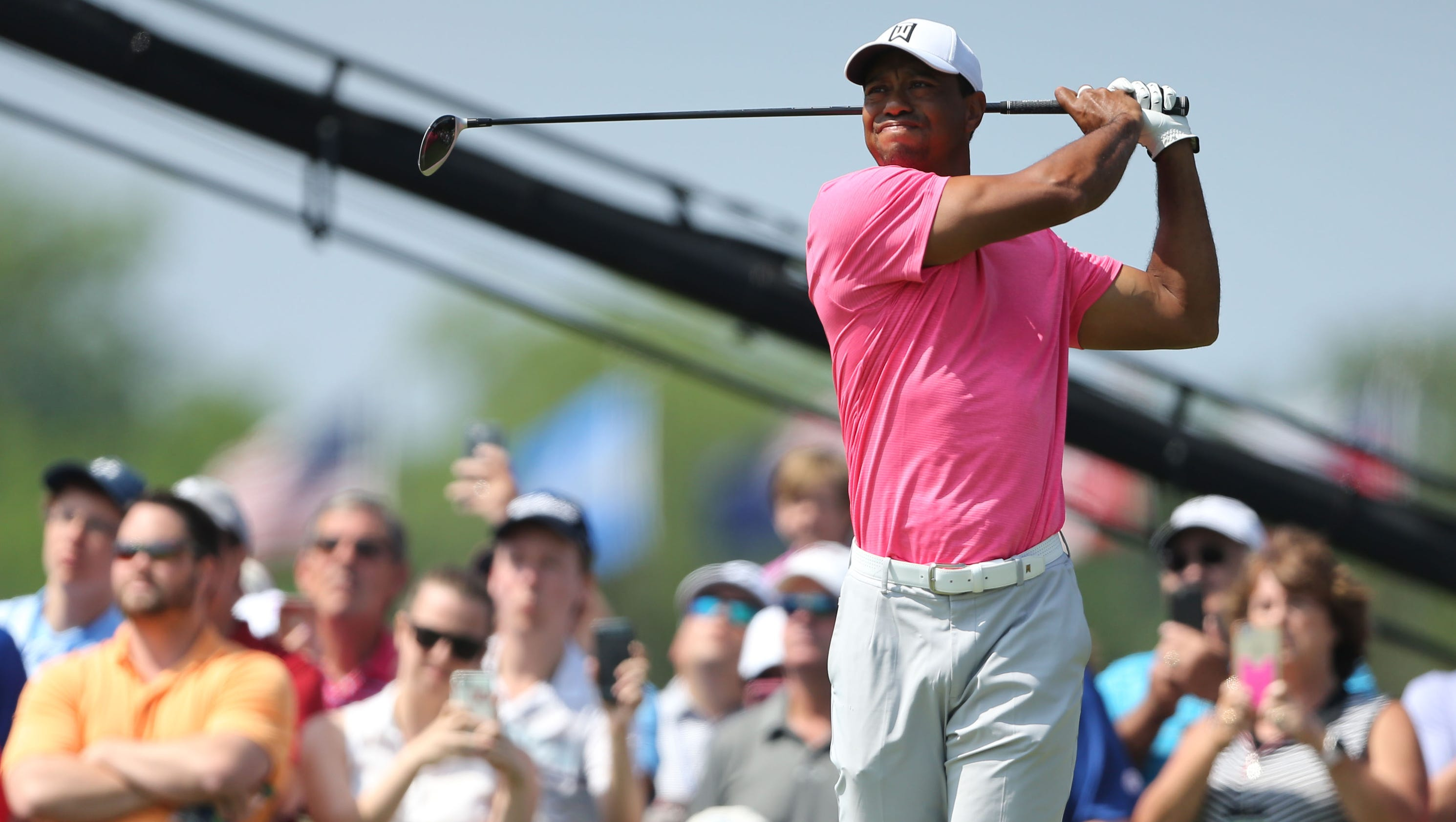 tiger woods charges up leaderboard with third
