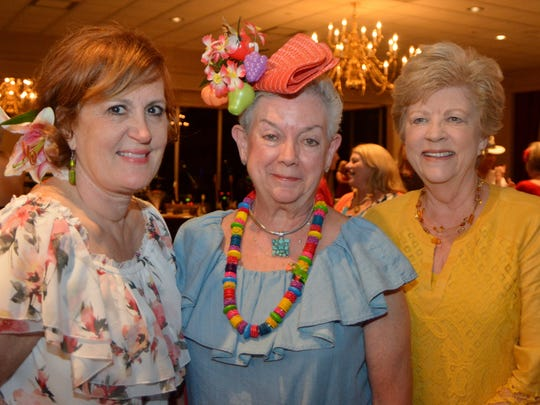 """Sharla McMichael, Sally Gardner, Helen Herzog were ready to party in costumes befitting the theme, """"Cruising to Cuba."""" They were at the  Justinian Midway to Mardi Gras soiree."""