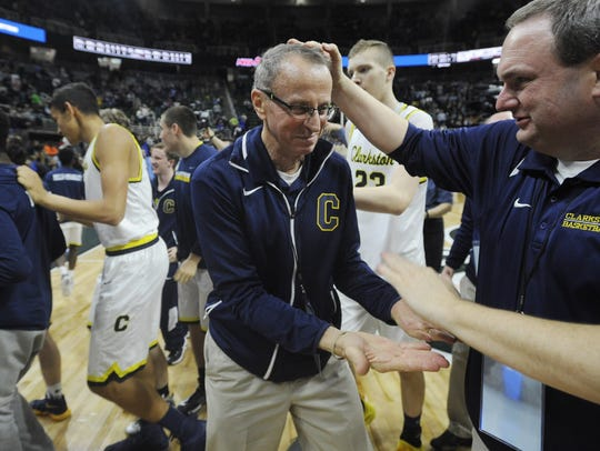 Clarkston head coach Dan Fife, left, accepts congratulations