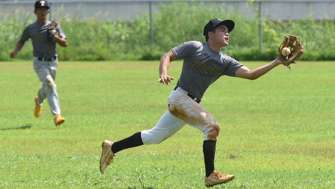The John F. Kennedy Islanders played the Tiyan Titans in an Independent Interscholastic Athletic Association of Guam Boys' Baseball League match at JFK on Nov. 14.