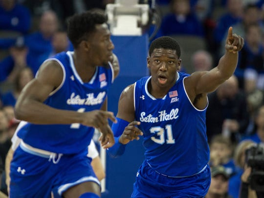 Seton Hall forwards Angel Delgado (31) and Michael