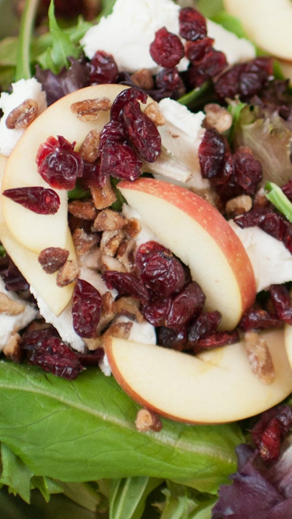 The Angry Goat chopped salad at Verde Salad & More features mixed greens, goat cheese, dried cranberries, apple slices, candied pecans and a pomegranate vinaigrette.