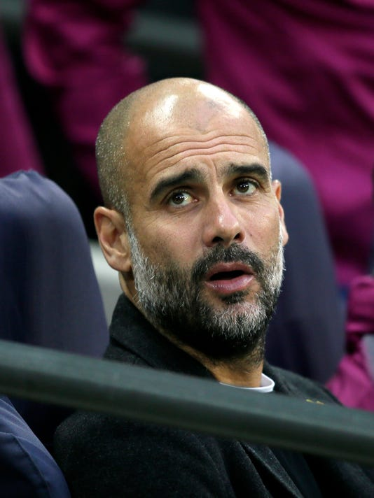 Manchester City coach Pep Guardiola sits on the bench during the English Premier League soccer match between Tottenham Hotspur and Manchester City at Wembley stadium in London, England, Saturday, April 14, 2018. (AP Photo/Tim Ireland)