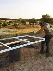 Teagan Hinrichs works to restore the popup camper trailer his great-grandfather made in 1955. Teagan won a blue ribbon and championship award for Southeast Warren FFA a the 2017 Iowa State Fair for his work.