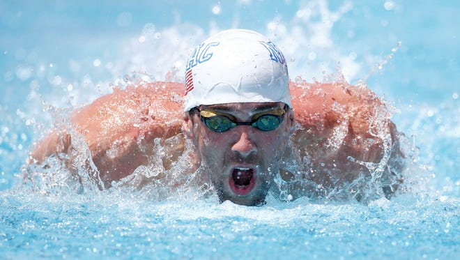 Michael Phelps swims in the 100 Meter Butterfly Prelims during the Arena Grand Prix Swim Meet on Thursday, April 24, 2014 at Skyline Aquatic Center in Mesa.