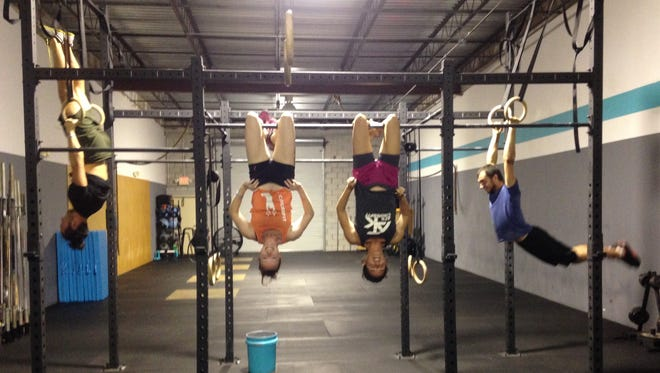 """Brittany Campos, 32, and Amber Kowalowski, 28, """"hang"""" out together after their workout at ATK CrossFit in Palm Bay."""