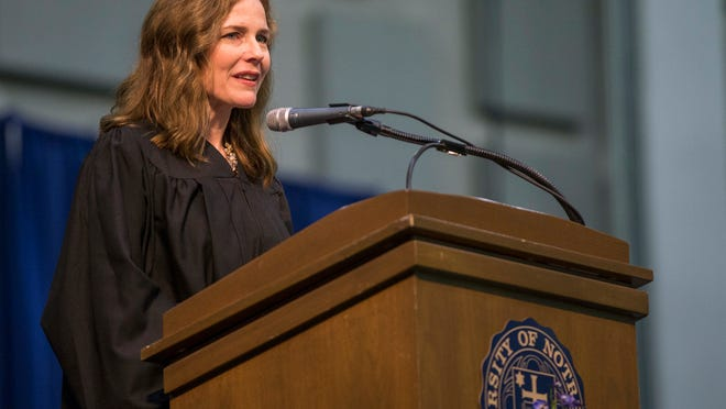 FILE - In this May 19, 2018, file photo, Amy Coney Barrett, United States Court of Appeals for the Seventh Circuit judge, speaks during the University of Notre Dame's Law School commencement ceremony at the university, in South Bend, Ind. Barrett, a front-runner to fill the Supreme Court seat vacated by the death of Justice Ruth Bader Ginsburg, has established herself as a reliable conservative on hot-button legal issues from abortion to gun control.