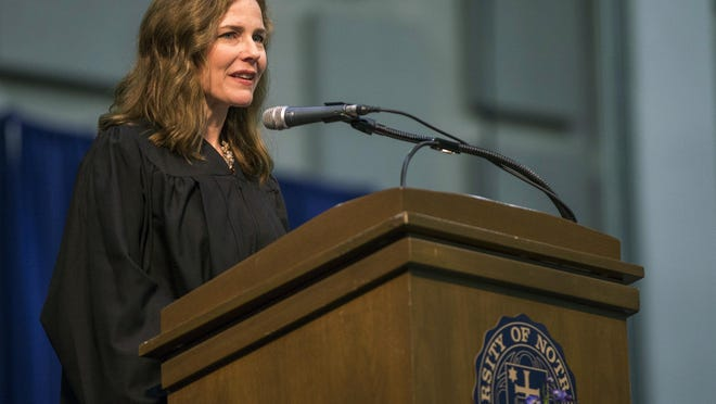 FILE - In this May 19, 2018 file photo, Amy Coney Barrett, United States Court of Appeals for the Seventh Circuit judge, speaks during the University of Notre Dame's Law School commencement ceremony at the University of Notre Dame in South Bend, Ind.