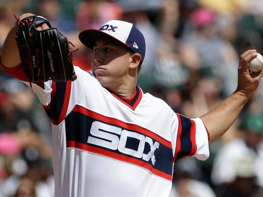 Chicago White Sox starting pitcher Derek Holland throws against the Kansas City Royals during the first inning of a baseball game, Sunday, Aug. 13, 2017, in Chicago. (AP Photo/Nam Y. Huh)