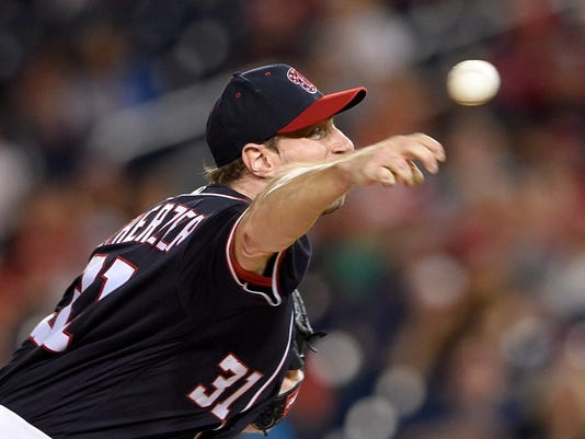 Washington Nationals starting pitcher Max Scherzer delivers during the third inning of a baseball game against the Philadelphia Phillies, Friday, Sept. 8, 2017, in Washington. (AP Photo/Nick Wass)