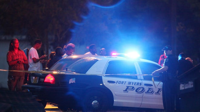 Members of the Fort Myers Police Department investigate the scene of a double homicide in Fort Myers on Thursday.