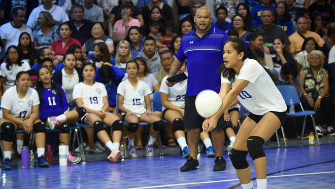 Destiny Castro, outside hitter for the Notre Dame Royals, bump passes to her setter in an Independent Interscholastic Athletic Association of Guam Girls' Volleyball League game against the Academy of Our Lady of Guam Cougars at ND on Sept. 29.