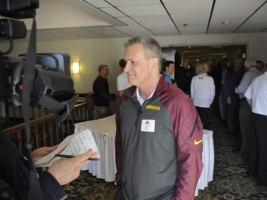 Former University of Minnesota men's hockey coach Don Lucia speaks with reporters during a Gopher Road Trip event in May 2014 in St. Cloud.  Lucia stepped down as Gophers coach Tuesday after 19 seasons.