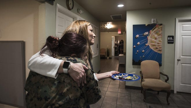 In this 2018 file photo, Stacy Johnson, founder/CEO of Central Texas Table of Grace, an emergency shelter in Round Rock for teens in the foster care system, shares a hug with a teen at the shelter.
