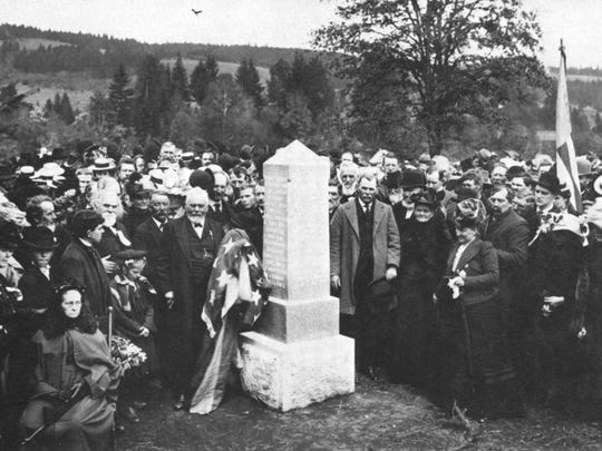 The Provisional Government Monument at Champoeg is dedicated on May 2, 1901. The man with the flag is Francis X. Matthieu, last surviving member of the group that established the Oregon Provisional Government in 1843.