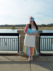 Carmel High School junior Danielle Rothchild models her bread tag dress, a recycling project that has inspired her to start her own nonprofit.